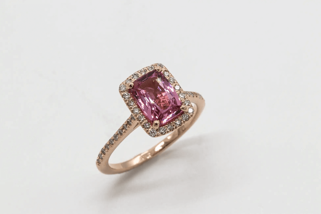 gold ring encrusted with diamond polished amethyst in the center