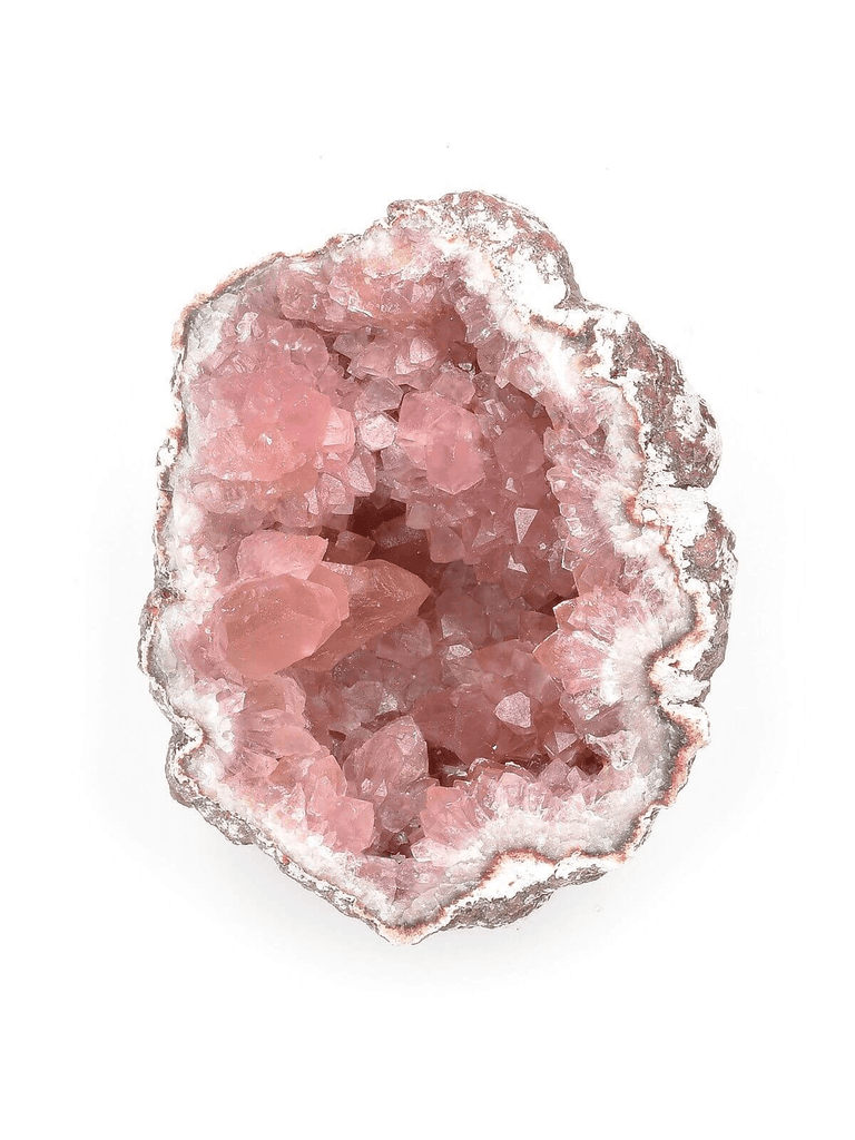 raw pink geode crystal close up view white background