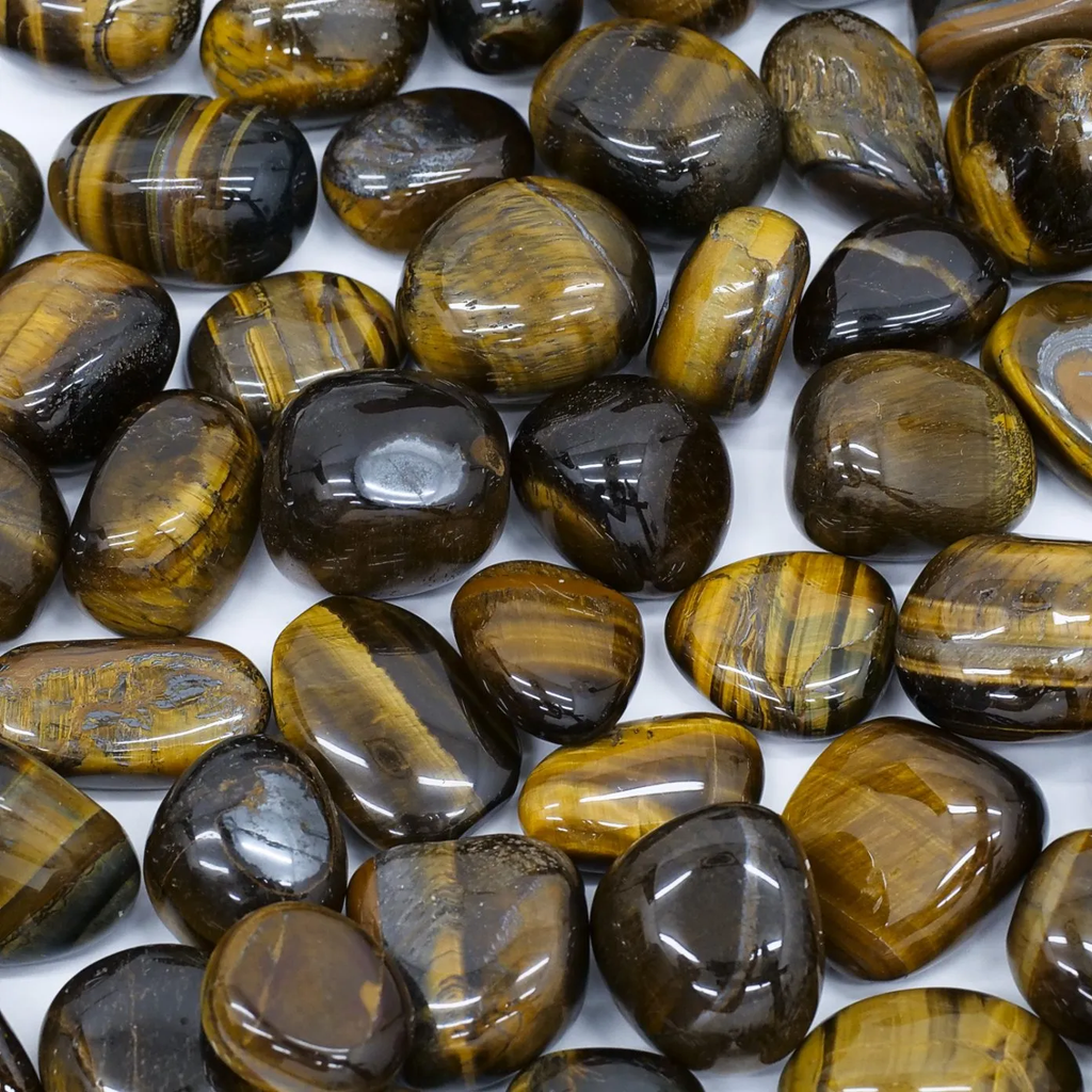 many pieces of smooth stones yellow with black linear pattern