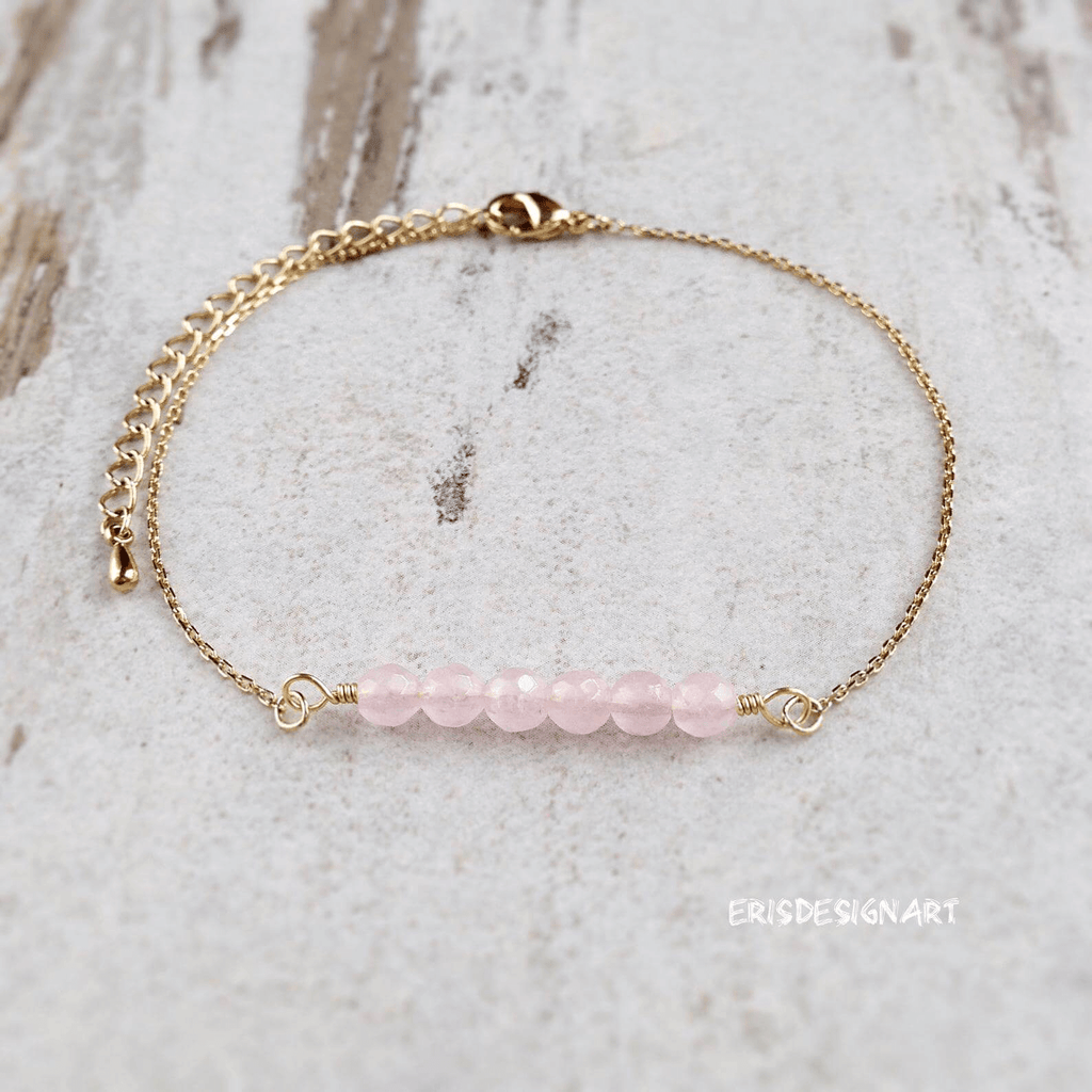 gold necklace with six round smooth pink stones pendant