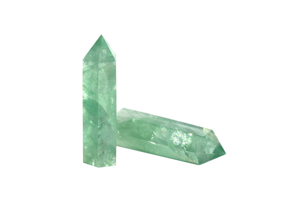 two pieces of green crystal prisms on white background