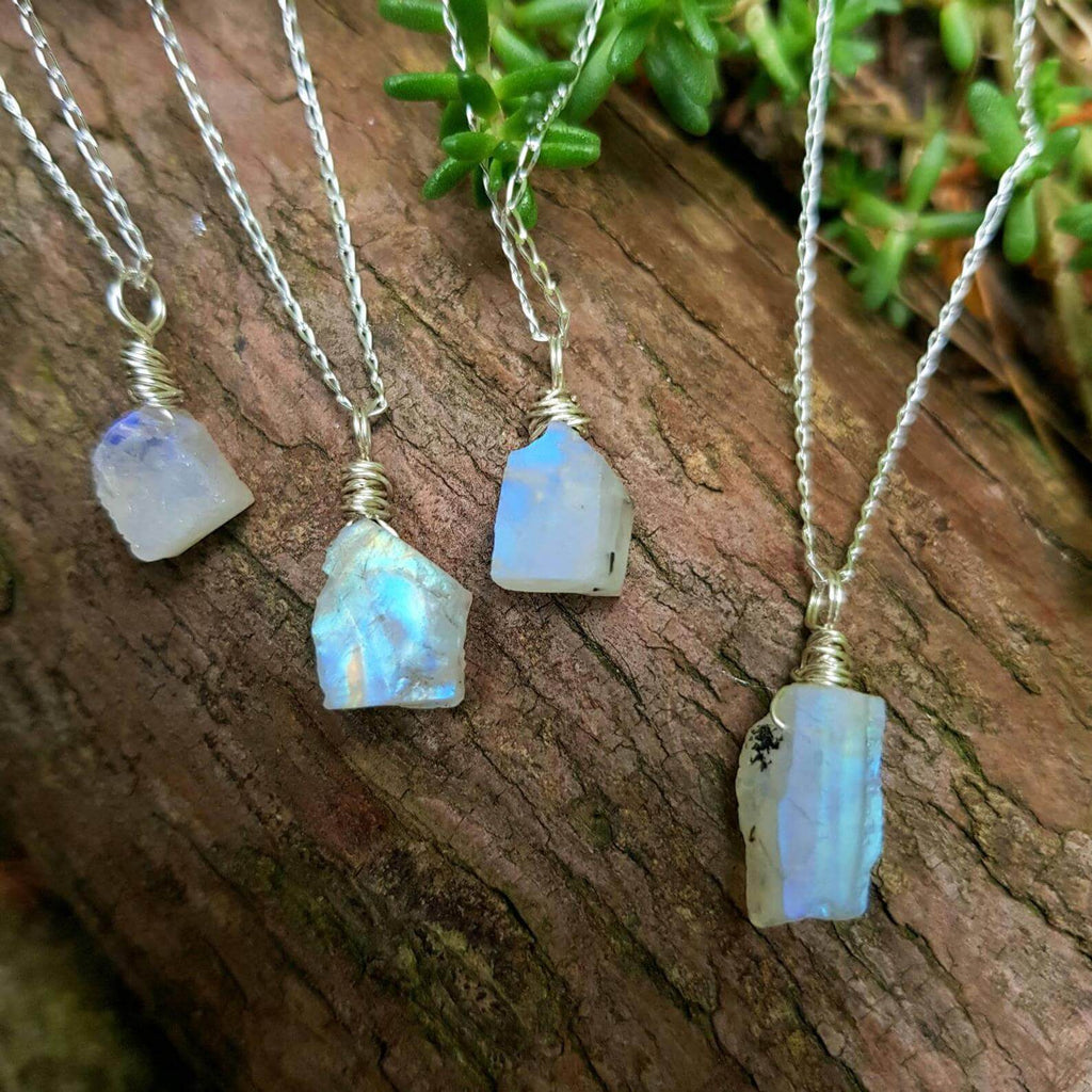four pieces of silver necklace with white crystal pendant