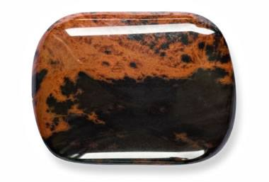 rectangular smooth brown stone with black spots close up view white background