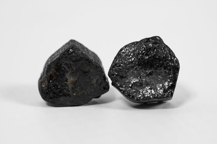 two pieces of raw unpolished black tourmaline close up view