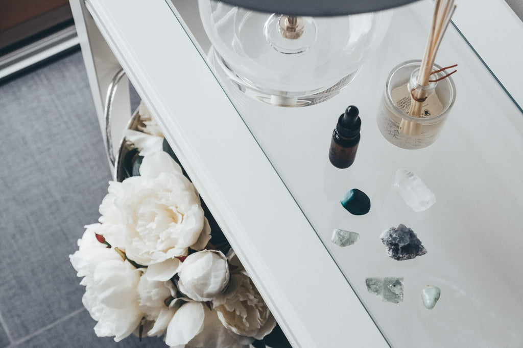 different types of smooth stone gems and crystals on glass surface counter
