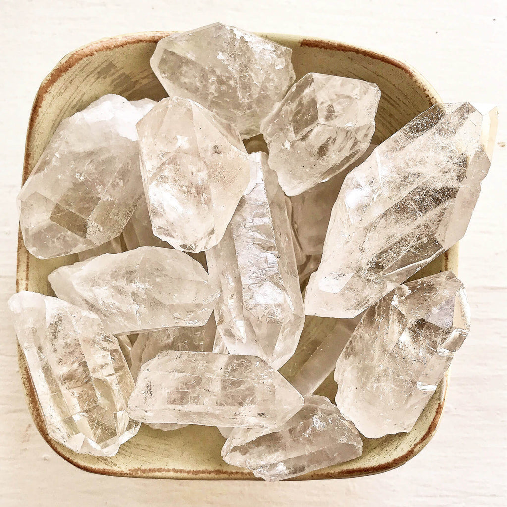 many pieces of white crystals placed on a square ceramic tray