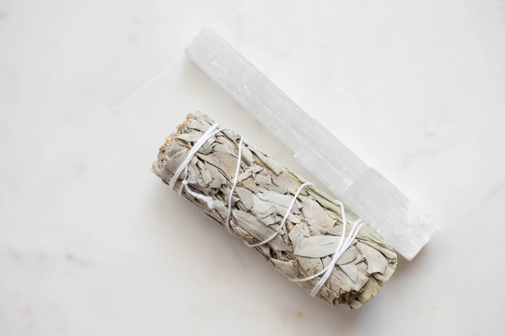 white thin crystal rock sage on the side white background