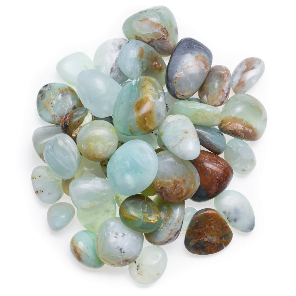 many pieces of varying shapes of opal white blue brown smooth stones