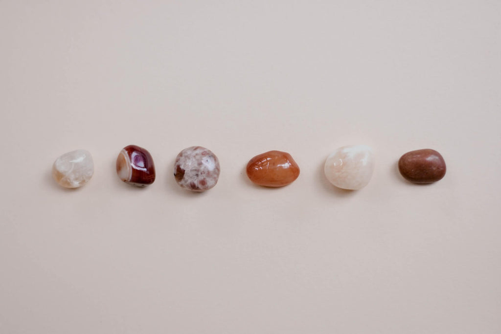 six different types of smooth stones arranged horizontally