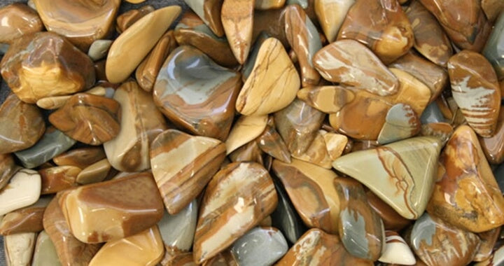 many pieces of brown smooth stones triangular shape different sizes