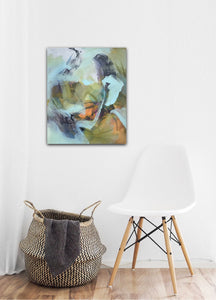 "Abstract expressionist art in the entrance area with a modern white chair and a basket- modern artwork and abstract portrait ""Mystery"". A modern acrylic painting by abstract artist Anja Stemmer. Visit my Picture Shop for affordable art online: Buy abstract paintings, modern acrylic paintings and works of abstract art on canvas or paper online. My high quality abstract art designs are hand painted."