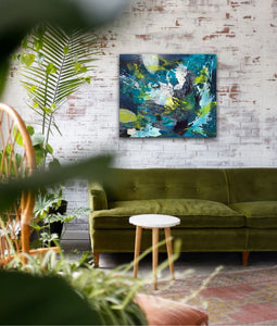 "Abstract expressionist artwork ""Aquamarine"" with blue, green and white shapes above a boho sofa in olive green - modern artwork. A modern acrylic painting by abstract artist Anja Stemmer. Visit my Picture Shop for affordable art online: Buy abstract paintings, modern acrylic paintings and works of abstract art on canvas or paper online. My high quality abstract art designs are hand painted."