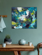 "Load image into Gallery viewer, Abstract expressionist artwork ""Aquamarine"" with blue, green and white shapes, on a colored wall and a dining table with tea pot - modern artwork. A modern acrylic painting by abstract artist Anja Stemmer. Visit my Picture Shop for affordable art online: Buy abstract paintings, modern acrylic paintings and works of abstract art on canvas or paper online. My high quality abstract art designs are hand painted."