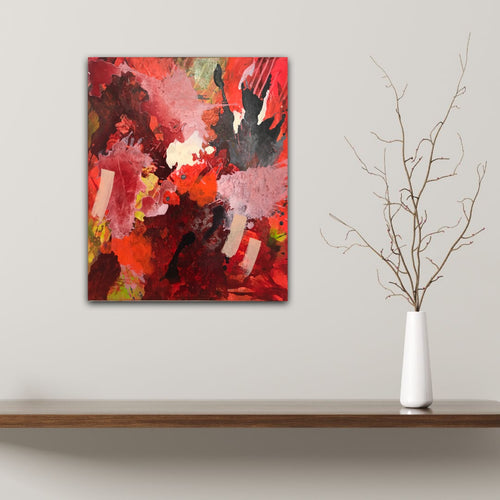 Abstract expressionist art on a wall over a wooden board and a vase with a twig - modern artwork