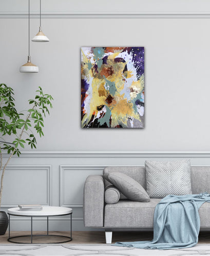Abstract expressionist art over a modern grey couch in a living room - modern artwork