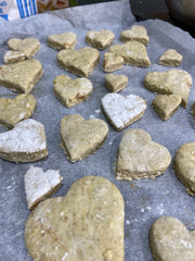Heart-shaped vegetarian dog biscuits ready to go in the oven