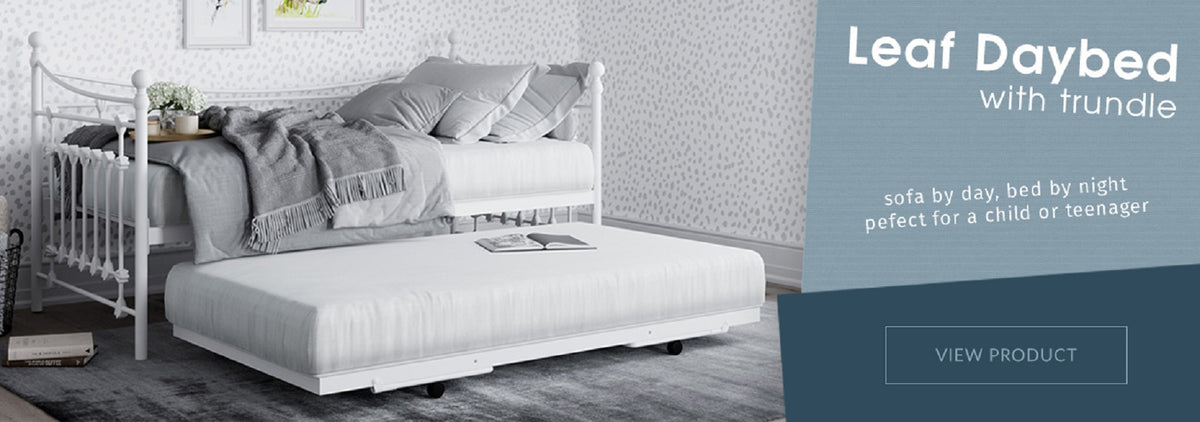 This classic design daybed with white finials and decorative joints, adds style to any bedroom. Use this as a single bed or a sofa to relax on in the bedroom with friends. Then why not have a sleepover on the pull out bed below. Available at Child Land