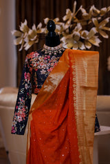 RUST COLOR SAREE WITH BLACK FLORAL EMBROIDERED BLOUSE