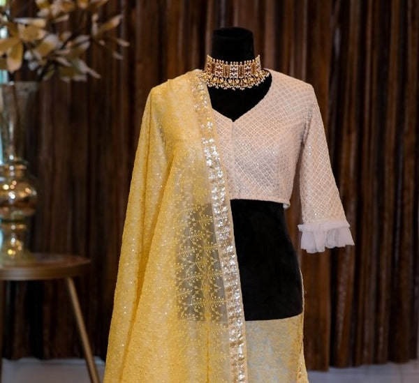 YELLOW ORGANZA EMBROIDERED SAREE WITH OFF WHITE BLOUSE