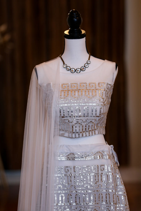 WHITE LEHENGA WITH GOTTA WORK