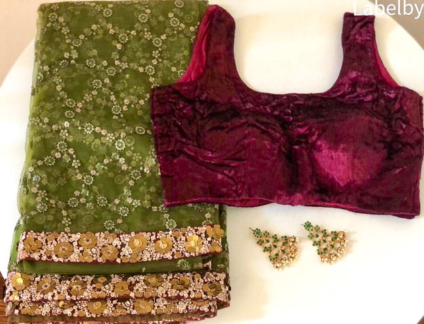 GREEN NET SAREE WITH MAROON VELVET BLOUSE