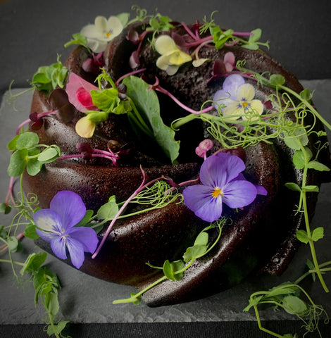 Secret Kiwi Kitchen Chocolate Cake with Flowers and Microgreens