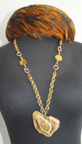 Large Earth Tone stone necklace on gold chain.