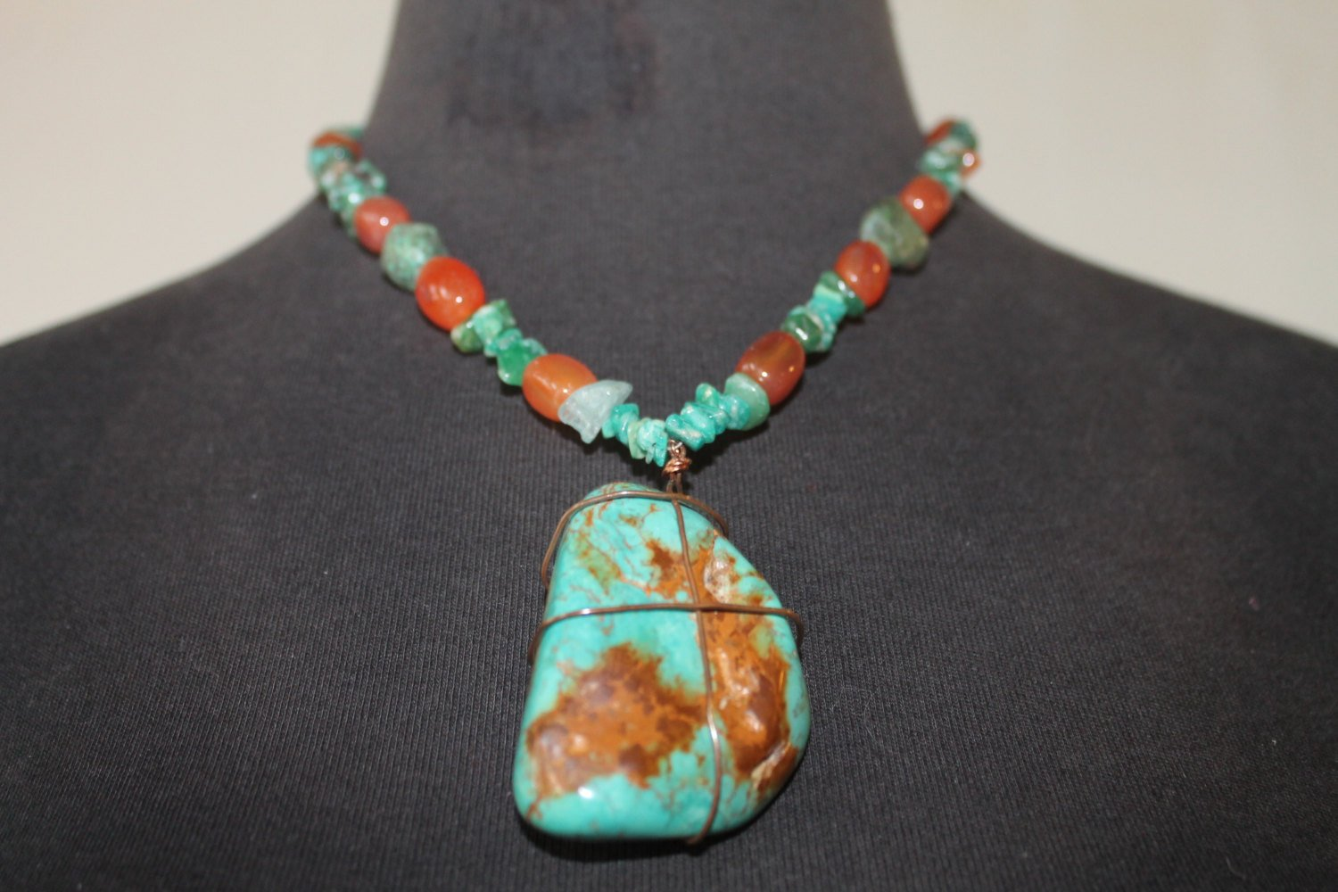 Turquoise wire wrapped necklace with carnelian and sterling silver clasp