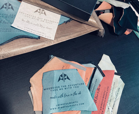 Heat press printing upcycled neoprene offcuts for swing tags.