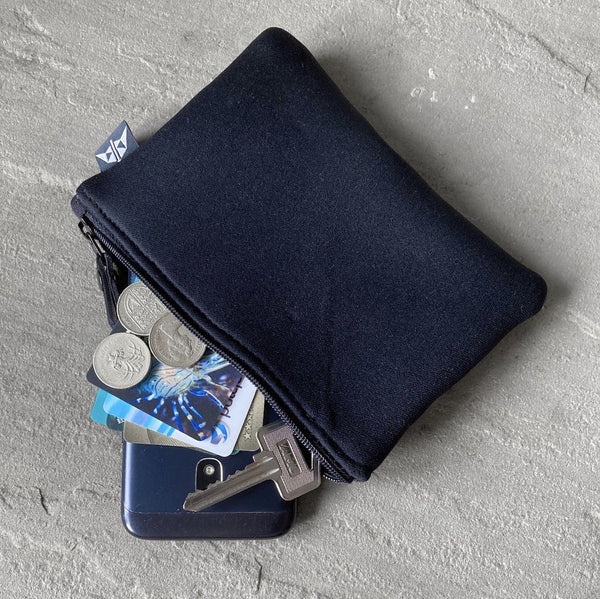Earthbound Rectangle Neoprene Pouch in Black with personal belongings