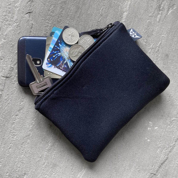 Grounded Rectangular Neoprene Pouch in Black with personal belongings