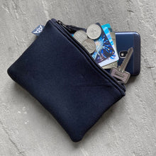 Load image into Gallery viewer, Earthbound Rectangle Neoprene Pouch in Black with personal belongings