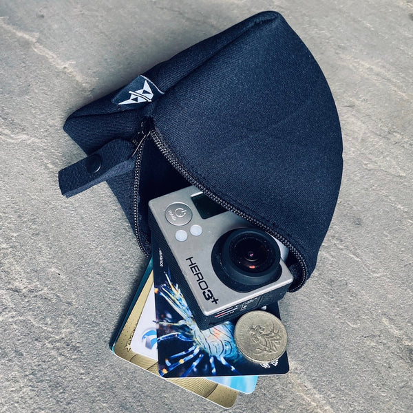 Trinity neoprene pyramid-shaped pouch, large in black with cards, coins and camera inside