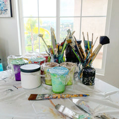 Artist Christine Krainock Palette Knives and Brushes in her art studio fine art paintings
