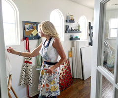 Contemporary Artist Christine Krainock painting original abstract palette knife paintings in art studio, Temecula, California
