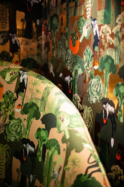 """Candice Held's """"Persimmon"""" Wallpaper and Upholstered Booth at Palm Springs Art Museum"""
