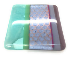 Mermaid fused glass coaster with pastel colours and coppery scales