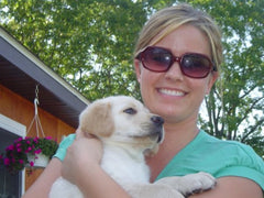 Tessa Burnett, owner of Hattie Rex, with Pablo, her first dog who inspired her to make dog tags