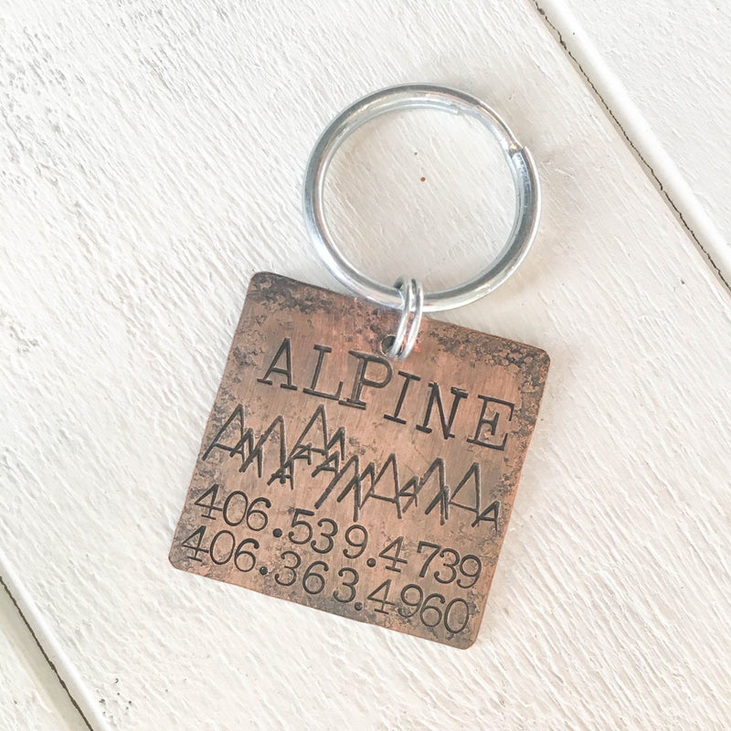 Mountain Dog Alpine dog name tag handmade in Bozeman, Montana.  Unique metal dog tags, pet id tags personalized for you, and handmade dog tag art make special gifts for special dog moms and dads.  Hammered silver jewelry for dogs and dog lovers.