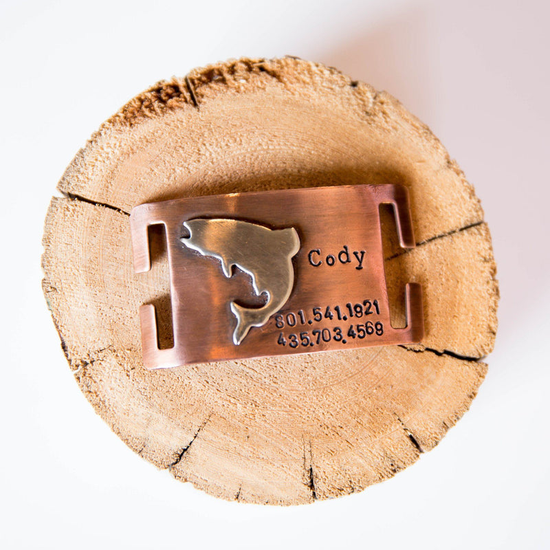 Fish dog id tag quiet collar dog name tag handmade in Bozeman, Montana.  Unique metal dog tags, pet id tags personalized.  Dog bone hammered silver and rose gold jewelry and dog tags for pets.