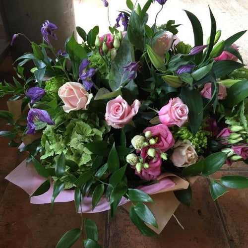 hand tied  pinks and purples bouquet