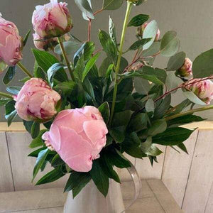 pinks and foliages bouquet in a jug