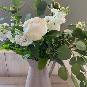All whites and foliages bouquet arranged in a jug