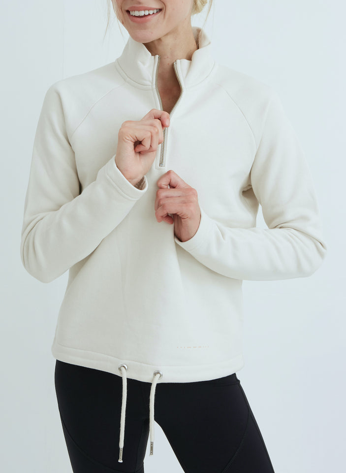 sustainable white sweater on model