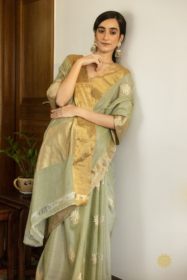 Handwoven Tussar Linen Saree In Sage Green With Gold Pallu and Booti