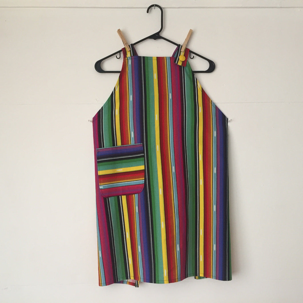 Bright colored Mexican serape stripes on lightweight black canvas. Chef style aprons are one size with two 35 inch ties that comfortably fit most body types. 100% cotton fabric, machine wash and dry.
