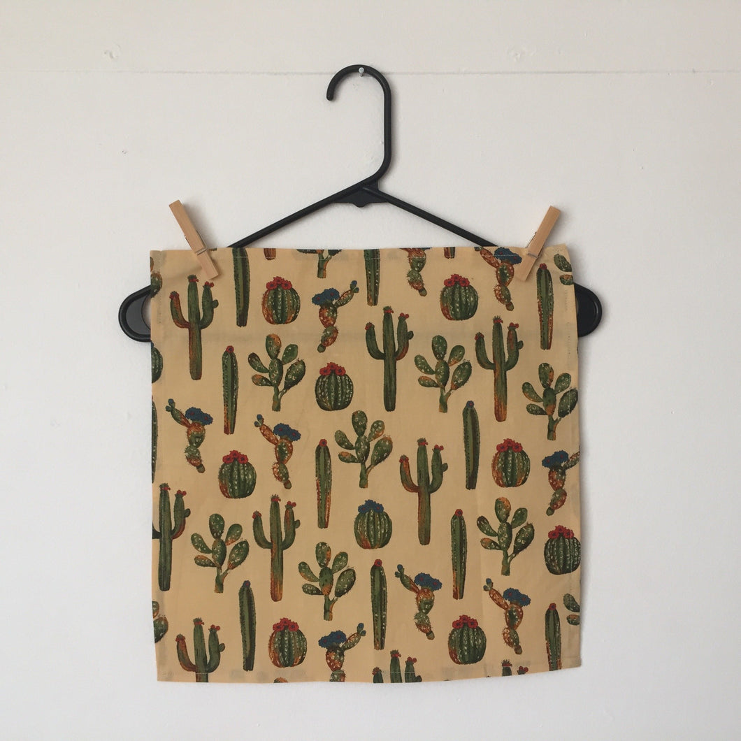 Set of four napkins with Southwestern cacti on a cream background. 100% cotton fabric, machine wash and dry.