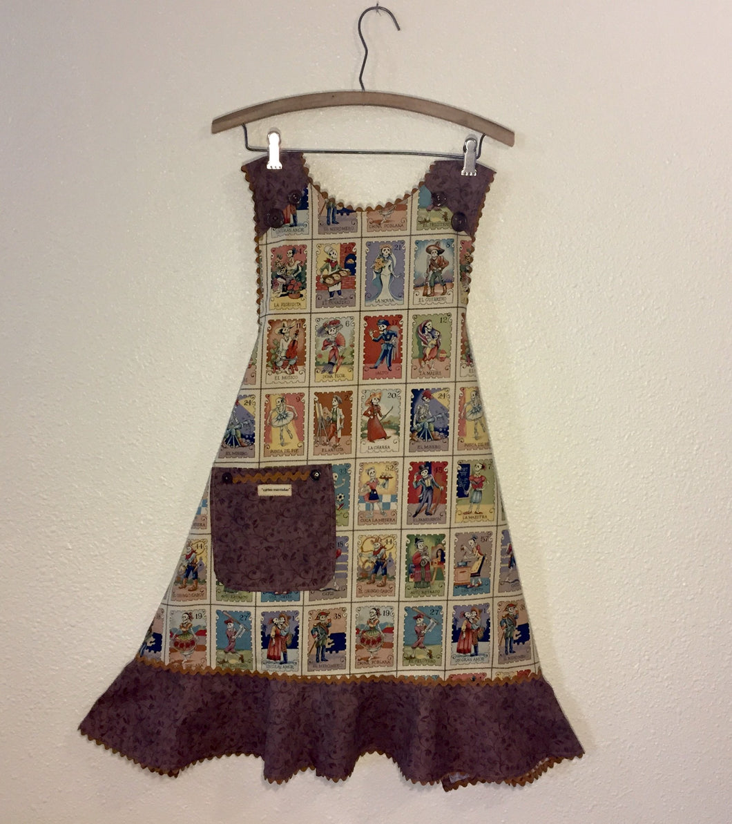 Image of apron with fabric printed with Mexican lotteria cards