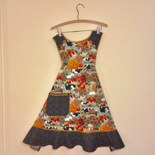 Fall farm scene with cows, pumpkins and sunflowers with black/white random dot ruffle and light brown rickrack