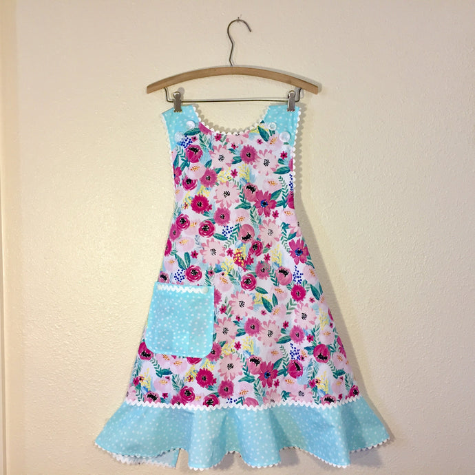 Image of apron with fabric printed with florals in bright colors